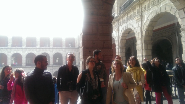 The motley crew of travel writers assembled to gaze at Rivera's masterpiece.
